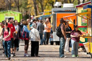 Students buying lunch from a number of food carts in Library Mall